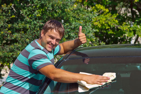 Commercial car washes use harsh chemicals that can damage your car's finish